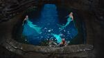 Nixie, Lyla, and Sirena sitting in the Moon Pool