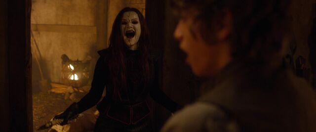 File:Laughs as Lucas kills his mother.jpg