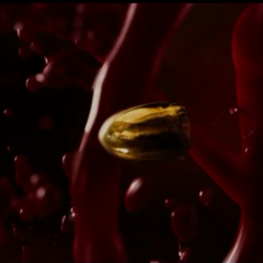 A bullet surrounded by blood.