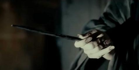 File:Voldemort holding Malfoy's wand.jpg