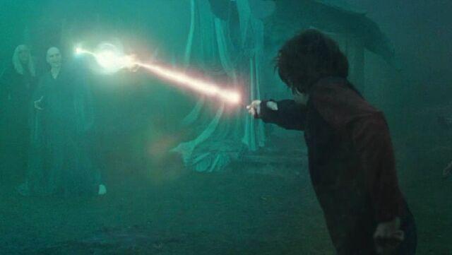 File:Harry dueling Voldemort.jpg