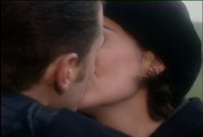 Mike and Jackie kiss in Testament