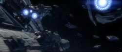 The UNSC Infinity and its UNSC Charon-class Light Frigates about to engage Covenant ships