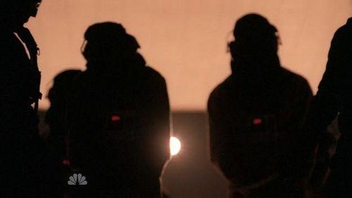 Hooded dark people