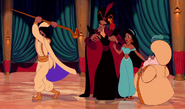 Aladdin smashing Jafar's staff to free the Sultan
