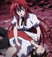 Rias frantically holding Issei