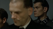 Gunsche notices Fegelein's entrance