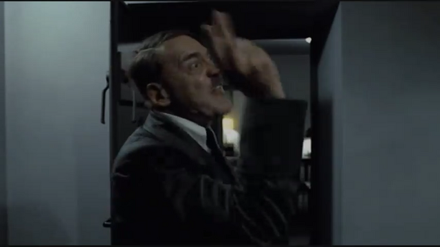 File:Hitler Phone Scene Hitler waves hand.png