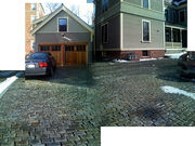 Lovely cobblestone drive... and lovely wood garage doors