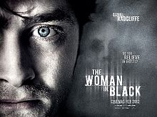 File-Womaninblackukposter