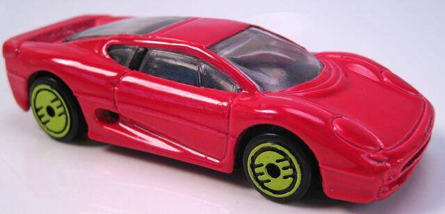 File:Jaguar XJ220 revealers series 1993 red.JPG