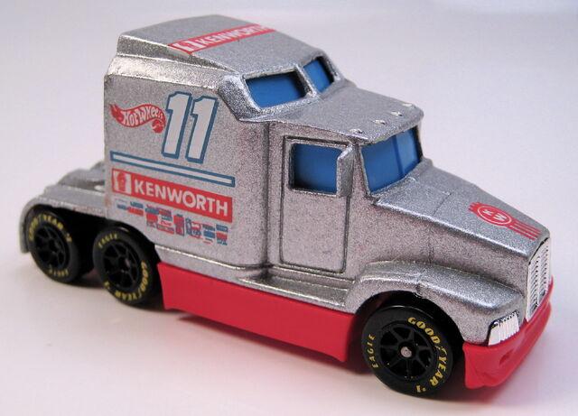 File:Kenworth racing trucks.JPG