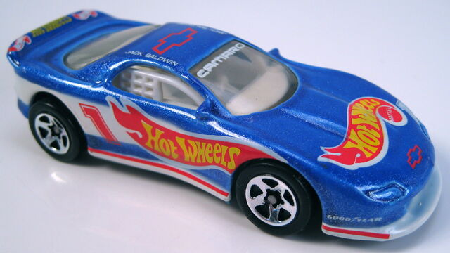 File:93 camaro early blue metalflake jack on roof 5sp grey mal base.JPG