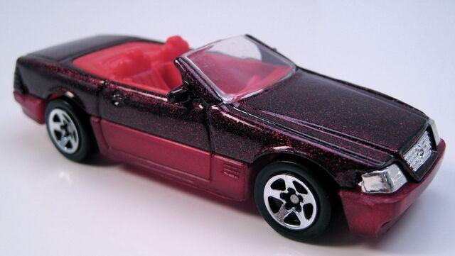 File:Mercedes Benz 500SL, black with red metalflake, 5sp, MAL, Avon set car.JPG