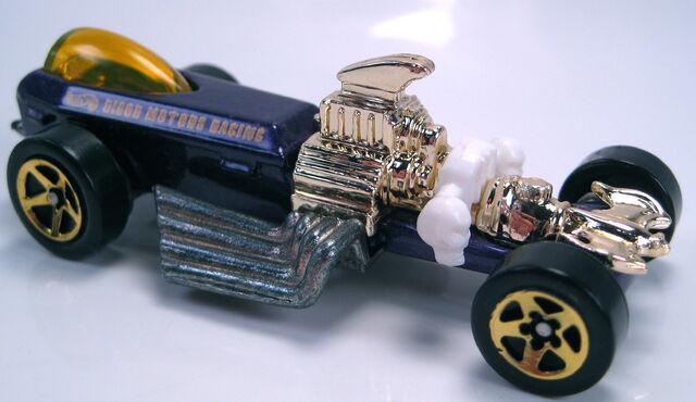 File:Rigor Motors purple metallic Mal base gold 5sp wheels 1999.JPG