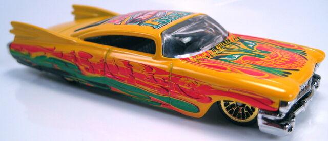 File:Custom 59 cadillac radical wrestlers series GOLD lace wheels 2003 .JPG