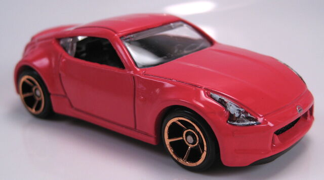 File:Nissan 370z red faster than ever wheels.JPG