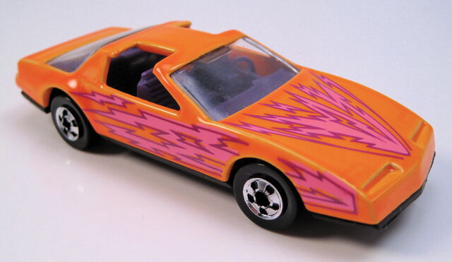 File:80s firebird neon orange purple int clear glass less 1 L Bolt on side BW MAL.JPG