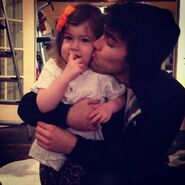 Max Schneider kissing his cousin