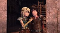 Astrid having put her right hand on Hiccup's shoulder