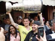 Andrew Ference lifts Stanley Cup during parade