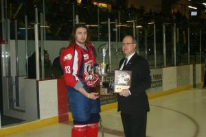 Brenden Kotyk accepting Top Defenseman award