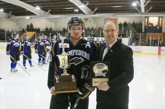 Clark Byczynski accepting Top Defenseman award