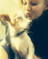 Olivia and a dog by IDDI liv getting ready