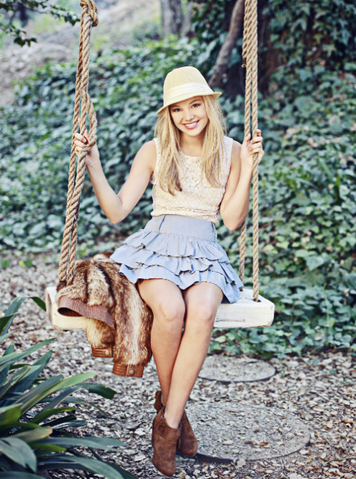 File:Olivia on a Swing.png