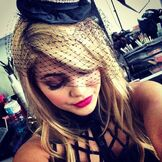 Olivia Holt Wearing a Hat and Pink Lipstick