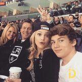 Olivia-holt-ice-hockey-game-with-family - 1
