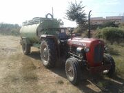A Tractor fitted with Water tanker