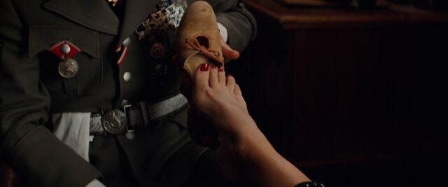 File:Hans Landa puts the shoe on her foot.jpg