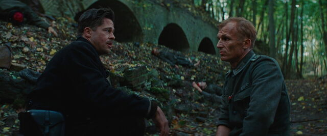 File:Aldo Raine talks to Werner without his hat.jpg