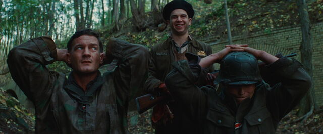 File:Hirschberg laughs as Butz and Ludwig look scared.jpg