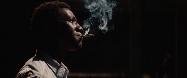 File:Marcel looks at the film smoking.jpg