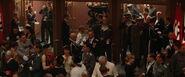 The Nazi crowd in the theatre hall