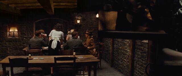 File:Mathilda serves schnapps as the three Basterds arrive.jpg