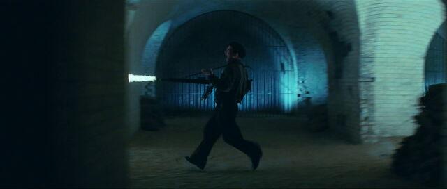 File:Hirschberg runs in jail firing his MG42.jpg