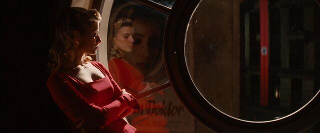 File:Shosanna looks outside the window as her time's up.jpg