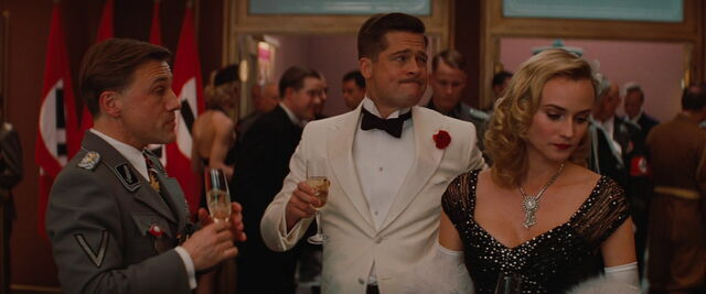 File:Aldo Raine with a glass of champagne and Landa.jpg