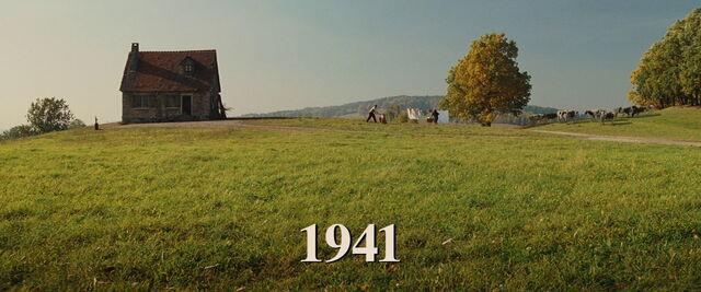 File:Perrier LaPadite chops wood Julie hangs sheets 1941 title.jpg