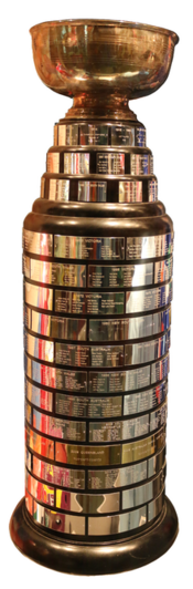 The Goodall Cup, with original cup on top, in the Hockey Hall of Fame 2014