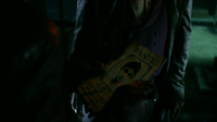 Sunny holds M.K.'s wanted poster