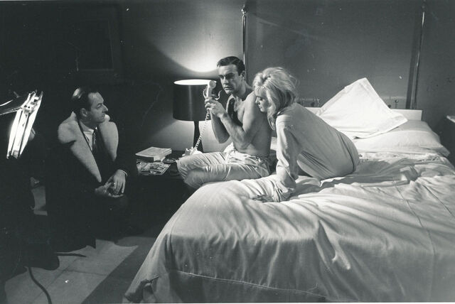 File:Sean-Connery-Shirley-Eaton-with-director-Guy-Hamilton-on-set-Goldfinger.jpg