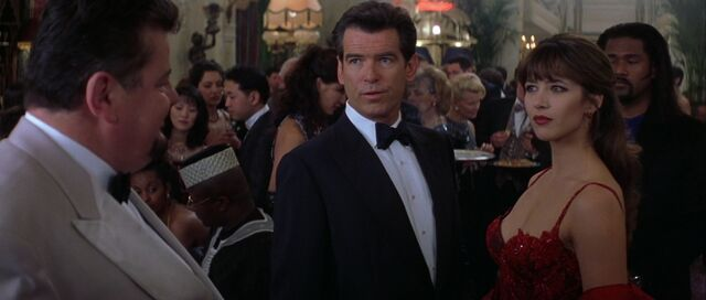 File:The World Is Not Enough - Elektra meets with Bond and Zukovsky in his casino.jpg