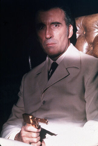 File:Scaramanga Seated.jpg