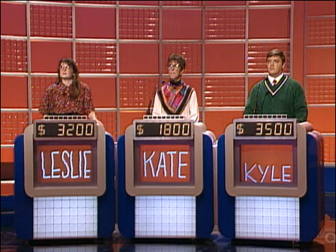 File:Jeopardy! 1991-1996 set with red backdrop and monitors.png