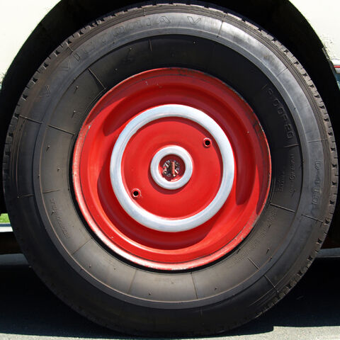 File:Red bus wheel.jpg
