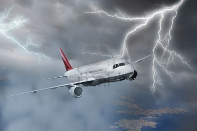 Airplane-flying-above-sea-on-stormy-sky